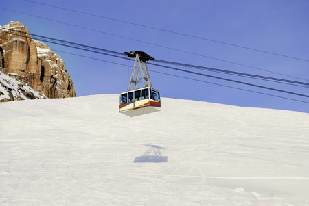 cable car in the winter to transport skiers in the Italian Alps photo