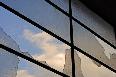 window and broken glass in old abandoned building photo
