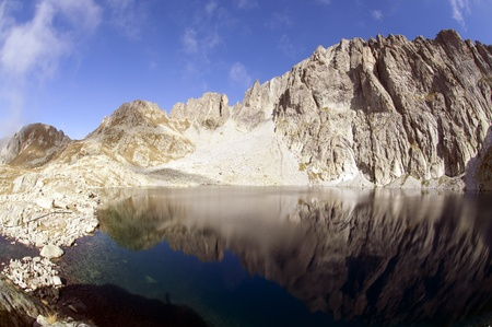 blue mountain lake with a reflection on the background of the Dolomites mountains photo