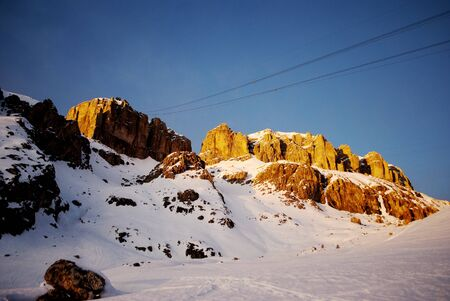 Dolomite mountains, sunset and blue sky Stock Photo