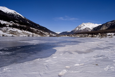Alpine Lake with snow, ice and water Stock Photo - 8869549