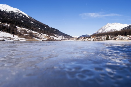 frozen lake in winter with the Alpine mountains and blue sky Stock Photo - 8869471