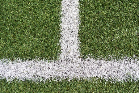 artificial grass with white lines for football field photo