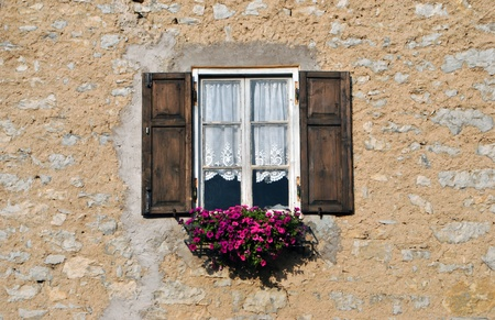 barn window decorations with flowers Tyrolean photo