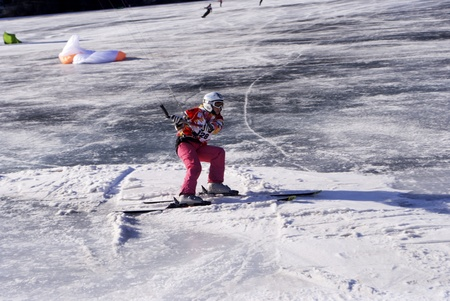 RESCHENSEE  - FEBRUARY 05: Competitor Polyakova Ludmila Snowkite World Championship February 01, 2011 In Reschensee, Trentino-South Tyrol, Italy. Winter extreme sport. Stock Photo - 8807755