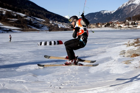 snowkiting: RESCHENSEE  - FEBRUARY 05: Competitor Petras Petr Snowkite World Championship February 01, 2011 In Reschensee, Trentino-South Tyrol, Italy. Winter extreme sport.