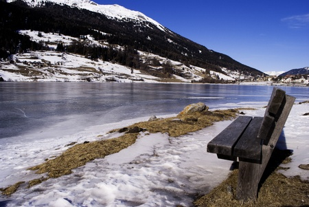Alpine Lake with snow, ice and water  photo