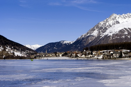 frozen lake in winter with the Alpine mountains and blue sky Stock Photo - 8869858