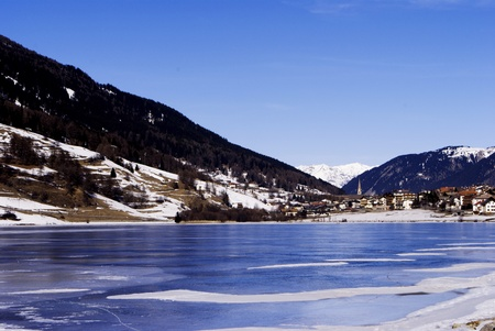 frozen lake in winter with the Alpine mountains and blue sky Stock Photo - 8869873