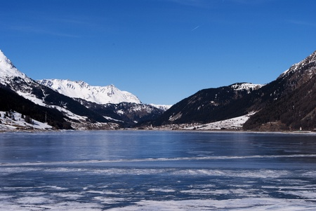 frozen lake in winter with the Alpine mountains and blue sky Stock Photo - 8869919