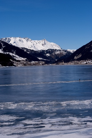 frozen lake in winter with the Alpine mountains and blue sky Stock Photo - 8869908