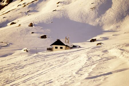 hut in the snow on the alps Stock Photo - 8869870