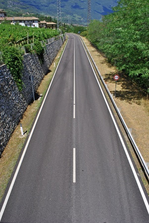dual carriageway with white stripes and black asphalt Stock Photo