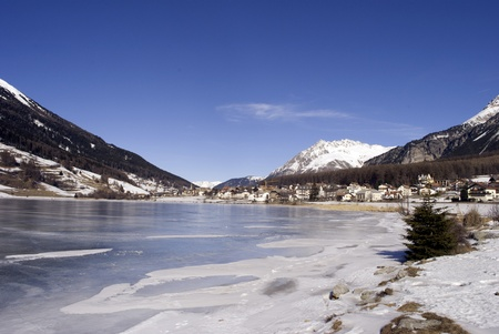 langdale pikes: frozen lake in winter with views of the mountains