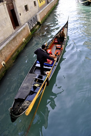 VENICE - MARCH 05: unidentified man rows his gondola for transporting tourists March 05, 2011 In Venice, Italy Stock Photo - 9063164