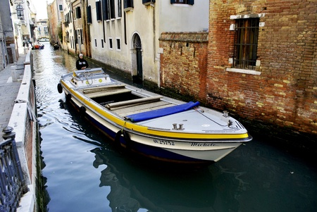 VENICE - MARCH 05: unknown person, sail boat in the canals of Venice March 05, 2011 In Venice, Veneto, Italy Stock Photo - 9073474