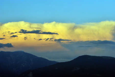 echoes: sunset with clouds of small mountains dolomites Stock Photo