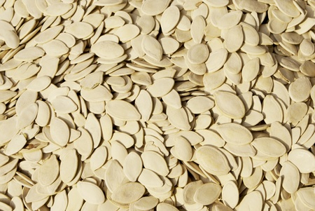 Toasted pumpkin seeds scattered in the basket photo