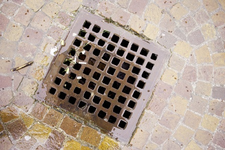 gutter to collect rainwater, sewer lid  photo