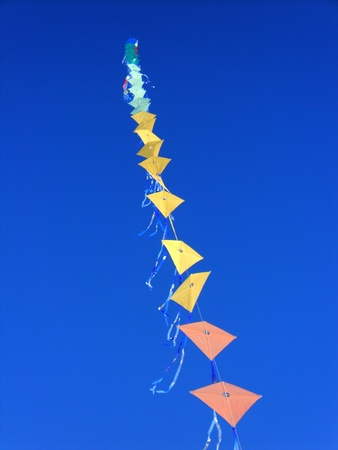 colorful kites flying in the blue sky photo
