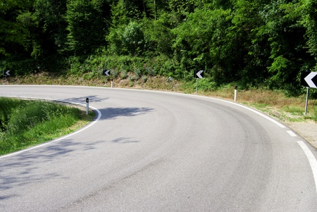 cornering: Serpentine mountain road in Italy