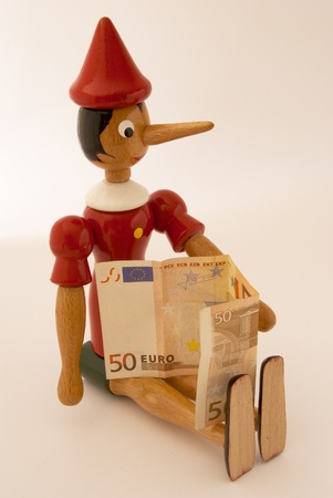 Pinocchio on white background with 50 euro Stock Photo - 9594685