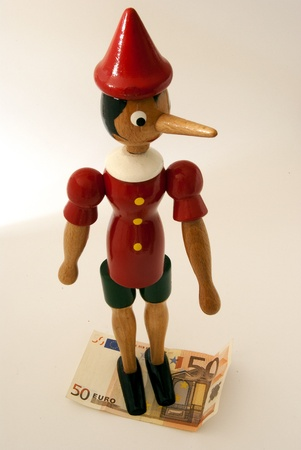 long nose: Pinocchio on white background with 50 euro