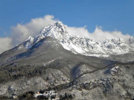 Small dolomite mountains, snow in spring photo