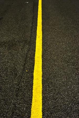 Yellow line on asphalt  photo