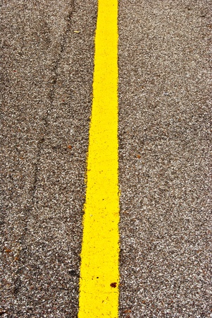 yellow line: Yellow line on asphalt