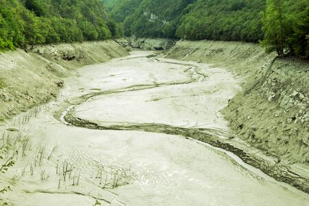 receded: Exposed lake bed in the high country of Italy after a dry summer period