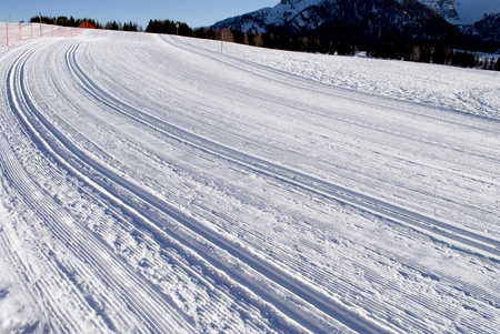 wintry landscape scenery with modified cross country skiing way. Bondone mountain in Trentino. Italy  photo