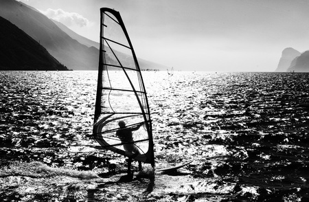 Surfing in the evening on the Garda lake,Torbole, Italy