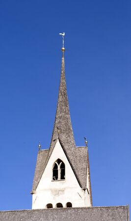 mountain church with the background of the Alps photo