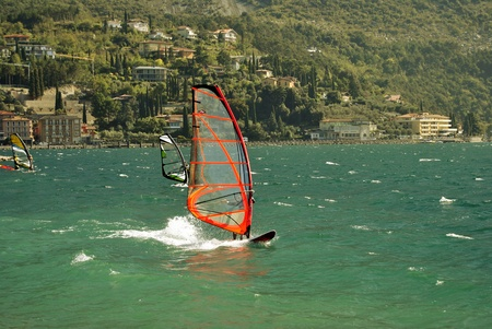 Surfing in the evening on the Garda lake,Torbole, Italy Stock Photo - 11453081