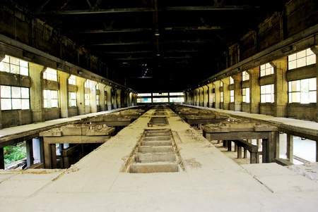 Abandoned factory room, with broken windows. photo