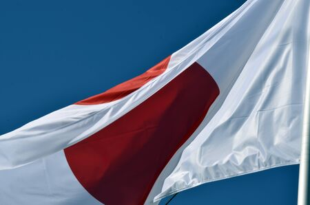 Flag of Japan with blue sky as background Stock Photo - 13301390