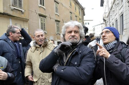 ROVERETO, ITALY - DEC 16: The showman and political figure, Beppe Grillo, presents the candidates at the elections of his political movement called Movimento Cinque Stelle Dec 16, 2012 in Rovereto, Italy.