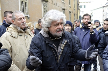 politican: ROVERETO, ITALY - DEC 16: The showman and political figure, Beppe Grillo, presents the candidates at the elections of his political movement called Movimento Cinque Stelle Dec 16, 2012 in Rovereto, Italy.