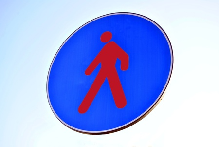 blue signage: Pedestrian walking lane walkway footpath road sign on pole post, large blue round isolated route traffic roadside signage