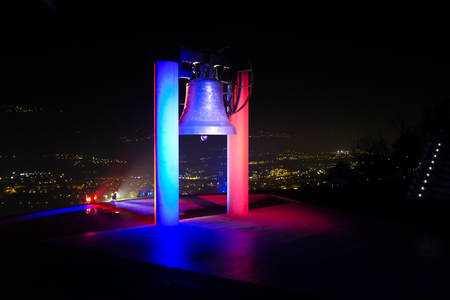 france: ROVERETO, ITALY - NOVEMBER 16, 2015: The great Peace Bell Dolens Mary  lit up with the Tricolor in a show of support for the people of France following the deadly terrorist attacks in Paris.