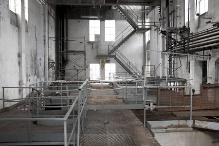 industry moody: The interior of an old abandoned machine hall, with the control room