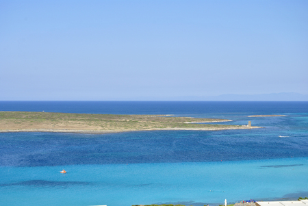 whiteness: View of La Pelosa beach, characterized by the transparency of its waters and the whiteness of its sand, is considered one of the most beautiful beaches in Sardinia, Italy