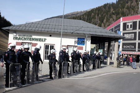 matrei: MATREI AM BRENNER, AUSTRIA - 03 APRIL 2016: Moments of tension between no-borders and Austrian police, unprepared for that event, he responds with pepper spray to ward off protesters that tried to advance further in Austria.