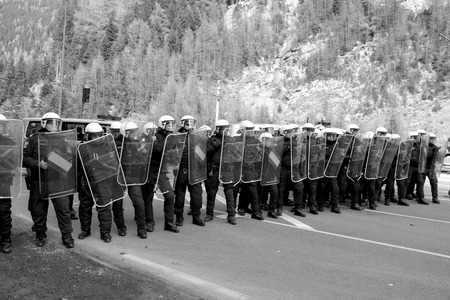 border patrol: MATREI AM BRENNER, AUSTRIA - 03 APRIL 2016: A protest took place today on the ItalianAustrian border after the Austrian governments decision to send the army to patrol the Brenner border and to stop the passage of migrants.