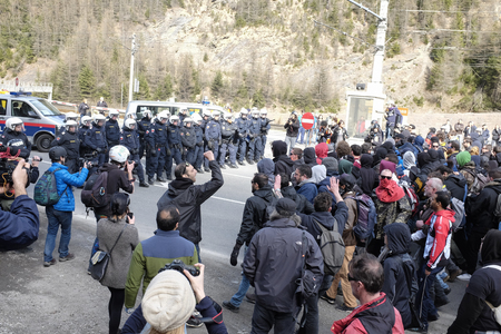 matrei: MATREI AM BRENNER, AUSTRIA - 03 APRIL 2016: The Austrian police try to control the protest against the closing of the border between Austria and Italy during the #Noborder rally held near Brennero.