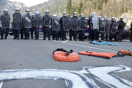 MATREI AM BRENNER, AUSTRIA - 03 APRIL 2016: The Austrian police try to control the protest against the closing of the border between Austria and Italy during the #Noborder rally held near Brennero. Editorial