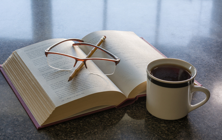Coffee in the morning with a good book to read Фото со стока
