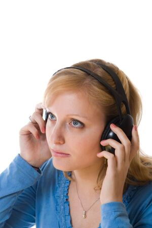 young woman listening to music on head phones