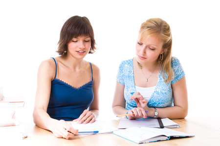 Two young women helping each other out in their studies